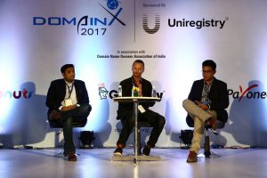 Sea Ansley (Mother.Domains) moderating a panel at DomainX 2017